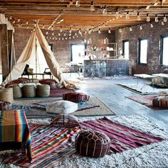 """We decked out this space at Pioneer Works in Brooklyn for a fundraiser. There were sitar players, a tarot-card reader in the tepee, and people lounging all over the floor pillows."""