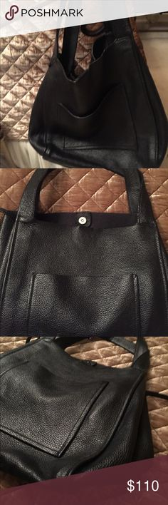 NWOT ZARA PEBBLED LEATHER TOTE. NWOT ZARA LARGE BLACK PEBBLED LEATHER TOTE!  This is a fabulous thick real leather bag.  I used it only one time.  The handles are double leather stitched large outside pocket.  Great for work, travel or fashion statement.  Fold in sides if you want a smaller look. Beautiful! Zara Bags Satchels