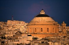 One of the world's largest unsupported domes (just under 40 metres across) tops a church amongst the buildings of Mosta - Malta