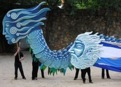 Adult puppet theater: puppet intervention and uprising --- cardboard dragon