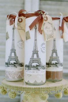Found Cat Studio8-- pillar candle with eiffel tower collages  wrapped with aged ribbon and tea stained tag