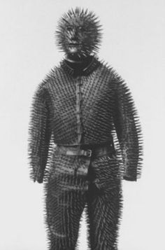 We've seen some deranged vintage body armor before, but nothing as gutsy as this costume, which transformed the wearer into a 19th-century Pinhead. A commenter on the Foundation of the American Institute for Conservation message boards had this to say about such a suit in 1998 (we're assuming this description refers to this particular regalia):