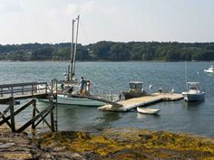 Deep water dock on Sturdivant Island just off Cumberland, Maine. This property is listed by The Swan Agency Sotheby's International Realty.