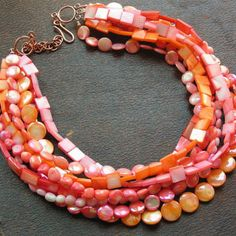 @-->----- { .n e c k l a c e s. } -----<--@ ~ a picture is worth a 1,000 words ... so I'll let it do all the talking! eight strands of coral and mother of pearl -- highly polished tangerine-melon-and shrimp pink AB/finish mother of pearl coins, petal-pink and tangerine mother of pearl square beads, with freeform angel-skin pink and melon coral nuggets ...a classic beauty that will serve you well and be a coveted adornment for years to come! clasp - lg copper hook w&...