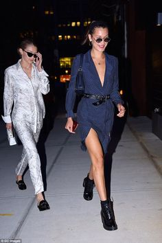All legs: Bella flashed her legs as she led the way with sister Gigi following in a silky patterned suit