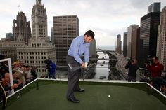 Jose Maria Olazabal, captain of the European Ryder Cup team, hits a shot from the 16th floor of the Trump International Hotel & Tower