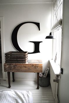typography at home, industrial letter above wood table