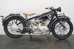 Launched in 1923, the first motorcycle to be sold as a BMW - the R32 - featured a 494cc, twin-cylinder, sidevalve engine having horizontally opposed cylinders, and this 'flat-twin' layout would forever be associated with the marque. The marque's first sports machine, the R37, appeared in 1924. The R37 boasted an overhead-valve engine producing almost double the R32's power output - 16hp, good enough for a top speed of more than 110kmh - but was produced for little more than a year (only… Antique Motorcycles, Bikes For Sale, Motorbikes, Bmw, Engine, Twin, Layout, Flat, Sports