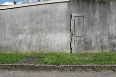 Humorous New Site Specific Paintings on the Streets of Paris by Pejac street art humor | he made use of a thick wall crack to form the edge of a ghostly looking door.