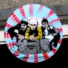 the Beastie Boys Spray-Painted on Record (Vinyl) BUY any 3 RECORDS get any 4th FREE. $35.00, via Etsy.