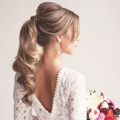 A perfect curled ponytail with volume up top for a polished look