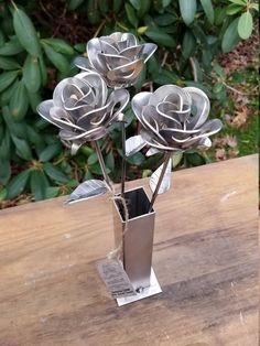 "Three Metal Roses and Vase, Recycled Metal Roses and Vase, Steampunk Roses Centerpiece, Unique Gift, Modern Rustic Home Decor Explore our website for additional info on ""metal art welded"". It is actually an exceptional place for more information. Welding Art Projects, Metal Art Projects, Diy Projects, Metal Sculpture Artists, Steel Sculpture, Art Sculptures, Metal Roses, Metal Flowers, Metal Welding"