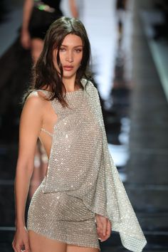 Bells Hadid looks super glam storming the runway at Alexandre Vauthier in this shimmering silver one shoulder minidress #flawlessfashion...x