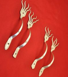 Funky fork cabinet pulls. Made by jjevensen. See link below to view these on Etsy.