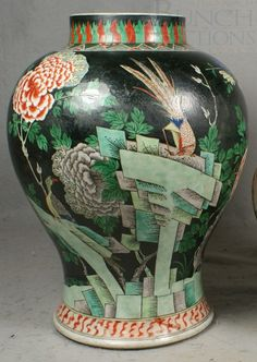 Chinese porcelain Famille Noire jar, baluster form body with exotic bird and prunus flower landscapes in green, blue, and white, base