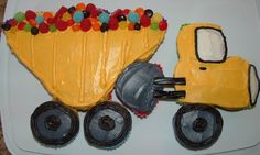 Dump Truck Cake pictures and how-to instructions. After moving to a new home, my son is obsessed with all the construction vehicles that are building the houses around our new home.