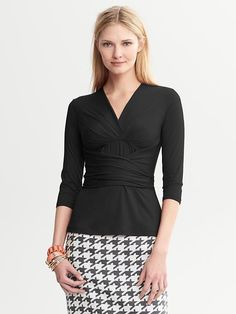 A basic no girl should be without - Banana Republic Issa Collection Black Wrap Top. Flattering & classic