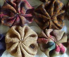 Closeup of silk yoyo scarf.  All made from varigated 1 inch yoyos:  http://needleprint.blogspot.com/2011/03/my-japanese-suffolk-puff-scarf-make.html