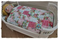 Patchwork blanket for the doll's bed
