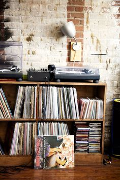 Note to self..Good record shelves are hard to find, they must be made...these need dividers so the records don't lean.
