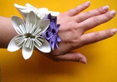 This is a great idea to celebrate someone that is having a wedding or baby shower. The soon to be should have one of my beautiful paper flowers around her wrist such as this corsage I made for a friend of a friend that was having one.