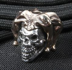 The GD Skulls Jester bead is handcrafted from beautifully burnished 925 silver and bronze. The manic grin of the skull mocks death while the sheen of the bead beg for noticing. Weighing 1.2 ounces, the bead is the perfect adornment for anyone who sneers at death. We are an authorized GD Skulls dealer. All of our GD Skulls products come with a signed Certificate of Authenticity card. GD products are hand-made of the highest quality 925 silver and bronze. All GD Skulls beads are marked with…