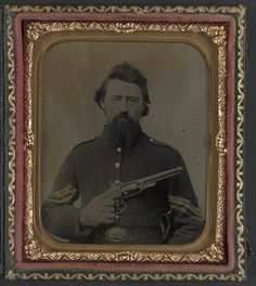 [Unidentified soldier in Union sergeant's uniform and U.S. belt buckle with Savage revolver] (LOC) by The Library of Congress, via Flickr