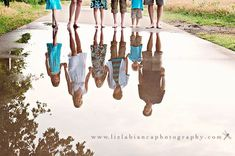 I LOVE this idea - family portrait in a puddle