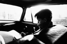 Audrey Hepburn is photographed by Mark Shaw as she reads her lines on the way to the set of Sabrina, 1953