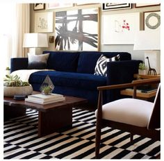 Navy couch and striped rug