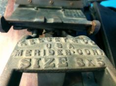 An antique miniature printing press in our Universal Wilde Rockland, MA plant