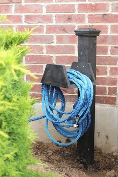 This fun DIY project keeps my garden hose hanging in style. I'm so happy the idea in my head translated into a fun and affordable design. Most of all, I am happy I am not tripping over my garden hose all the time.