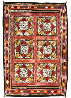 Ralli quilt, Chauhan People, Sindh, Pakistan, circa 1950-1980. A classic from Badin, Southern Sindh, this ralli's striking white, black, red, and yellow color scheme in ornate appliqué is the hallmark of the work of the Muslim Chauhan quilters. Possibly a dowry quilt, this ralli also displays traditional use of mirrors and sequins.