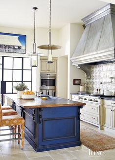 Mediterranean Cream Kitchen with Blue Island