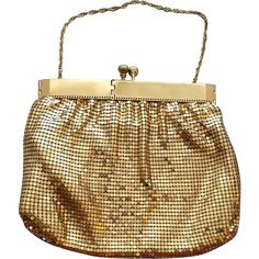 Gorgeous, late 1940s to early 1950s, Gold metal mesh evening purse with the Duramesh label and an unusual opening. Offered at an introductory Sale