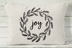 "Decorative throw pillow covers are a quick and easy way to decorate your home for holidays. Change your pillow cover and you have a whole new look! This 12 x 16 holiday pillow reads ""joy"" within an evergreen Christmas wreath. Handmade with natural cotton, it is perfectly neutral to complement any decor. DETAILS • 12"" x 16"" pillow cover. • Printed in black with permanent, water resistant ink. • Envelope style back closure. • Pillow insert is not included.  FABRIC OPTIONS • White: 100% cotton…"