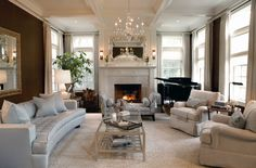 Stunning living room. Love the use of the backless settee in front of the fireplace