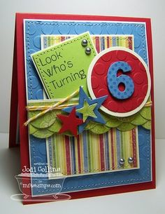 embossing, layering, bright primary colors and cute die cut shapes/numbers!
