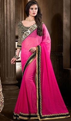 Let every eye around you gaze at your endearing charm as you are draped in this lace work sari in pink color chiffon and jacquard. The brilliant attire creates a dramatic canvas with amazing resham and sequins work. #chiffonsarees #onlinechiffonsari #pinksaree