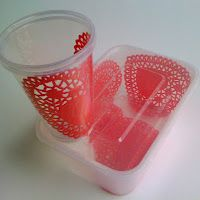 Sandwich a heart doily between two plastic party cups to make cute party cups.