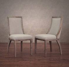 Expecting inlaws? Knock em' off their feet and right into these upholstered beauties. The angled back legs and distressed wood frame keep these from looking like they belong at Aunt Mildy's in Connecticut. We think they'd compliment a round or oval dining table best. A curve for a curve! Just make sure to give these a quick scotchguarding before you serve your first five star meal!  Park Avenue Beige Linen Dining chair, set of 2, Overstock.com, $319.99