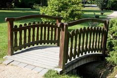 This bridge adopts more of a picket fence design, and lets the light aging give the structure character.