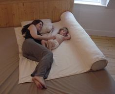 This is a great attachment parenting way to co-sleep. It is also a pregnancy body pillow. (It isn't exactly Montessori... but I think it is a good option for the first few months of life).