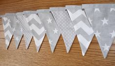 This lovely 2 metre bunting features eight double-sided flags on a 2m line of grey bias binding. Flags are double sided, making them stronger and more robust. These flags will not fray! Each flag is patterned on the front with plain fabric on the back. Flags measure approx. 13cm x 11cm each. This 2m bunting is handmade in the UK and is perfect for a babys nursery or childs bedroom. Please dont hesitate to contact me via Etsy conversation if you have any questions. Thanks for looking :)