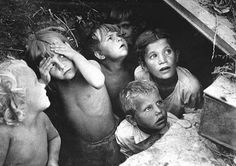 L. Konov - Terrified Russian children in Stalingrad are hiding from German bombers, 1942