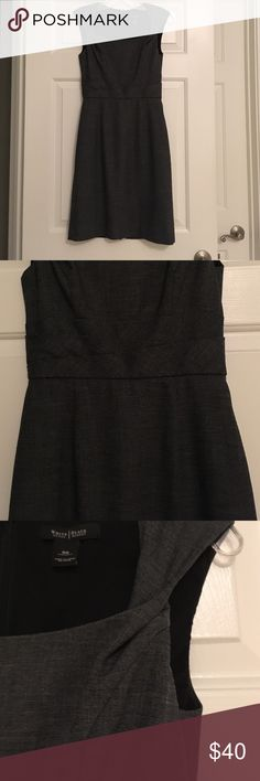 Dark gray WHBM Sheath Dress Perfect with heels and pearls for work! Gorgeous sheath dress in dark gray from WHBM has a kind of twisted look to the waistband area (see 2nd pic). Straps are also twisted for added detailing (see 3rd pic). Back zip. I always get so many compliments, but it's time for someone else to receive them! Always professionally dry cleaned and from a smoke free home. White House Black Market Dresses Midi
