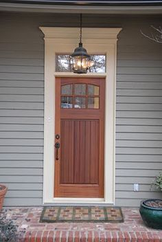 Craftsman Door with s Simple Pediment. Love the transom above the door instead of side lites to let in more natural light