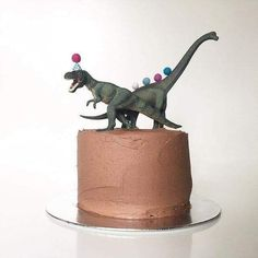 pin via My beautiful Rixy turns 4 tomorrow and starts our roll of birthdays. He's going to die when he sees his cake. I got the cool dinosaurs from and I've chosen different animal themes for all 3 of the boys. Such a simple idea to pimp up a cake! Dino Cake, Dinosaur Cake, Dinosaur Birthday Party, Birthday Party Themes, Themed Parties, Birthday Ideas, 3rd Birthday, Birthday Cakes For Boys, Dessert Party
