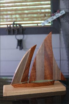 Wooden Sailboat - The jib (front sail) can swing back and forth allowing you to adjust how you want it to look when on your tabletop. Each piece of wood has its own unique appearance and varies slightly so each sailboat will be unique.  This makes a great gift for many occasions including Birthdays, Father's Day, 5 Year Anniversary, or for yourself. Sailboat Lovers, Sailboat Collectors, or Nautical Lovers of all ages will love it. http://woodsmithofnaples.com/wooden_sailboat_5.html