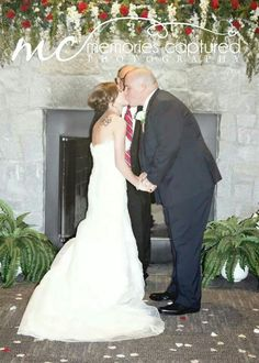 Kiss the bride. Wedding day at Memories Captured Photography